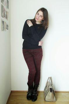 Shop this look on Lookastic:  https://lookastic.com/women/looks/crew-neck-sweater-skinny-jeans-boots-satchel-bag-ring/5944  — Black Crew-neck Sweater  — Burgundy Skinny Jeans  — Gold Ring  — Black Studded Leather Boots  — Beige Leather Satchel Bag