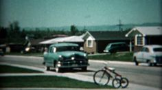 1961: New family car pulls into driveway for inspection by excited family. http://www.pond5.com/stock-footage/57468772?ref=StockFilm keywords:family, car, new, arrives, comes, here, greeting, welcome, wave, summer, sunshine, dodge, open, door, celebration, buying, consumer, 1961, 1960s, 8mm, film, old, times, tv, commercial, home movie, vintage, retro, archive, nostalgia, memories, throwback, Americana, documentary, editorial, historic, preserve, restore, real, classic, era, priceless…