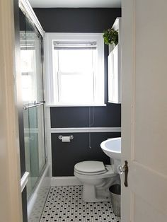 nice small bathroom -- like the grey walls with the b & w tile floors
