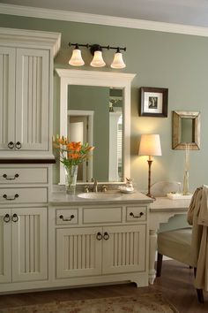 Medallion Cabinetry Platinum inset bath vanity shown in Dana Point door style in maple Oyster Vintage paint