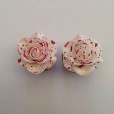 Bloody Rose Ear Plugs. reminds me SO much of alice in wonderland