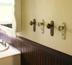 Old door knobs to hang towels.