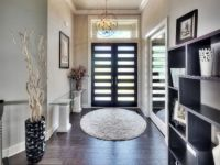 This custom made front entry door fits right into this contemporary modern designed custom home with vaulted ceilings, amazing light fixtures, and dramatic dark stained hardwood floors. Modern Contemporary, Modern Design, Laguna Hills, Entry Doors, Front Entry, Hardwood Floors, Flooring, Plan Design, Home Builders