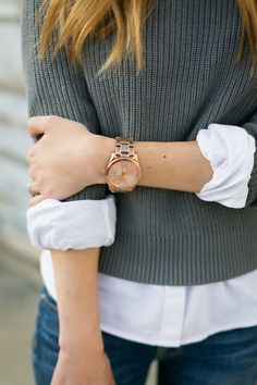 white button up with gray sweater rose gold