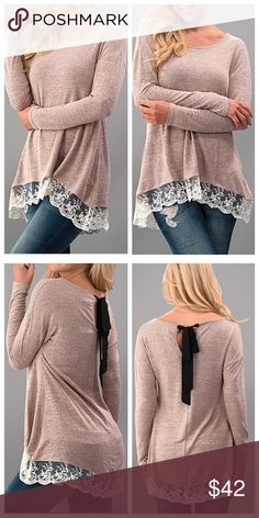 Dusty Pink Top with Lace This dusty pink long-sleeved top has a lace trim and black tie in back. 65% polyester 35% rayon. Tops Tees - Long Sleeve