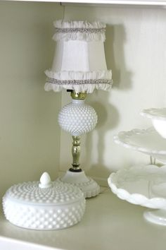 A Milk Glass lamp, candy dish and cake stand are just a few of my favorite pieces. #kitchen #decor #thrift
