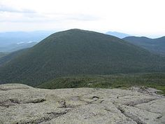 Mount Skylight is a mountain in the Great Range of the Adirondack High Peaks in the Adirondack Mountains of New York. It gets its name from its open, bare and relatively flat summit, unusual in the Adirondack High Peaks.