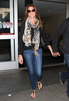 Cindy Crawford's simple look is a smart go-to combination anytime your agenda calls for a flight. Pick your most comfortable pair of jeans, and pair them with a neutral-colored top. Wear shoes that'll be easy to get on and off at the security line, and finish with a lightweight scarf that can be repurposed as a pillow or blanket when you're midflight.