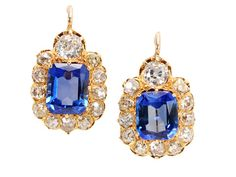 Victorian circa 1890. Ultimate luxury rears its gorgeous head in a pair of 18k yellow gold earrings. As though descended from the heavens, emerald cut natural blue sapphires (guaranteed to be not heat treated) of an estimated 1.88 carats and 2.08 carats shine with celestial light. Each is framed with a surround of twelve (12) old mine cut diamonds with an estimated total diamond weight of .75 carats (K-M color range; SI1 clarity).