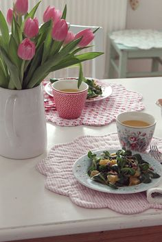 Tulips with polka dotted place mats. :)