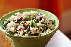 Delicious rice salad with wild rice and long grain rice, green onions, celery, peas, dried cranberries, pine nuts, in a sesame vinegar and oil dressing.  Looks good!!