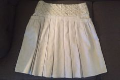 Alice+Olivia gray pleated skirt with crystal/sequin details size 6. Rent now for $50/week