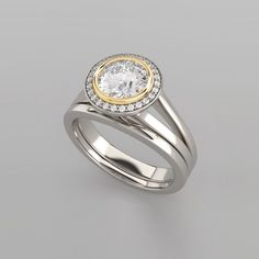 ROUND BRILLIANT DIAMOND BEZEL SET HALO TWO TONE GOLD ENGAGEMENT RING MODERN AND SOPHISTICATED JUST LIKE YOU!