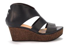 Megaumi by Coclico This sandal is a sleek combination of European sophistication and summer fun. The dark cork and matte leather means it will pair perfectly with that little black dress, or pair it with capris and shorts for a casual, stylish look.  •  Smooth matte leather upper•  Rubber sole•  Zip closure up back•  Padded leather footbed•  Dark cork wedge•  Made in Spain •  Measurements:-  Heel height: 3 in- Platform height: 1 1/2 in