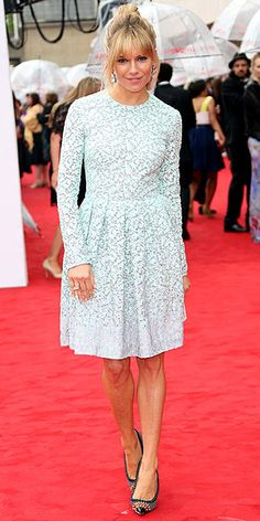 in a pale-blue embroidered Matthew Williamson number with spiked Christian Louboutins (may 2013)