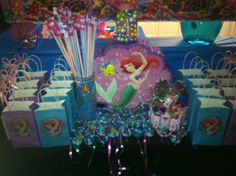 Mermaid party cut out paperhats from party city and glued on plain bags for goody bags mm cups with swedish fish little metal treasure box filled with goodies as a prize