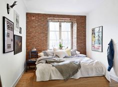 My type of style. Beautiful brick accent wall. Minimal space, but decor creates the looks of spaciousness.