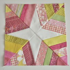 This pattern looks really cool-the bonus is by using all different size strips for the outside part, you don't have to match everything up