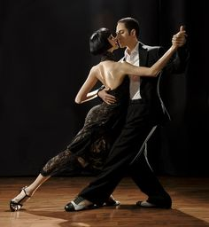 TANGO ! Argentine Tango. Beautiful couple dancing tango.