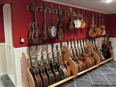 here's a well organized music room thanks to some guitar wall mounts and stands from GuitarStorage.com