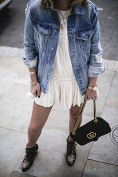 Oversized denim jacket over a summer neutral colored dress with booties in early fall!