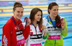 Silver medal winner Jazmin Carlin of Great Britain smiles with Gold medal winner Boglarka Kapas of Hungary and Tjasa Oder of Slovenia in the Women's 800m Freestyle Final during the 33rd LEN European Swimming Championships 2016 at Aquatics Centre on May 19, 2016 in London, England.