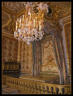 Versailles - Queen's Bedchamber.  There is a barely discernible 'hidden door' in the corner near the jewel cabinet by Schwerdfeger (1787) through which Marie Antoinette escaped the night of 5/6 October 1789 when the Paris mob stormed Versailles.