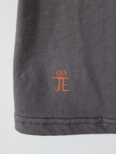 We included a miniature version of our JessE Designs logo on the front of the Stone Yoga tee on the lower right-hand corner. It is a nice little accent to the overall design.