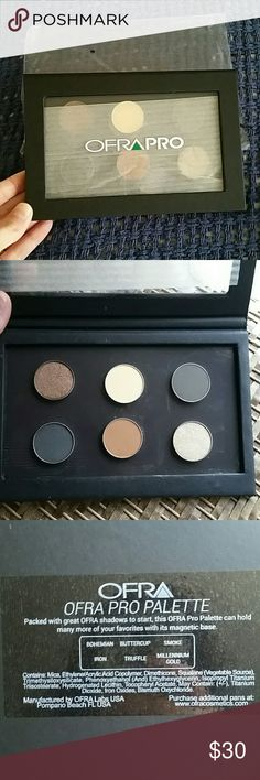 New Ofra Pro Magnetic Palette with 6 Eyeshadows New in Package Ofra Pro Magnetic Palette  NEVER SWABBED May have light powder in palette due to travel Magnetic and can add many more pans Colors are: Bohemian,  Buttercup,  Smoke,  Iron,  Truffle,  and Millennium Gold Such Beautiful Colors that can be worn alone or blended I don't wear Eyeshadows  Due to the magnetic nature,  palettes may be in a different order,  the order of the names of the colors are same order as photo 2! Ask Questions…