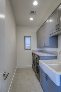 Alair Homes   Scottsdale   Minnezona   Custom Home Stacked Washer Dryer, Washer And Dryer, Custom Homes, Kitchen Cabinets, Home Appliances, Home Decor, Laundry Room, Restaining Kitchen Cabinets, House Appliances