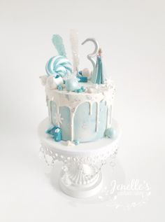 Frozen themed drip cake. By Jenelle's Custom Cakes.