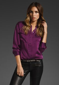 Drape-y purple, button-down blouse paired with cool pants.