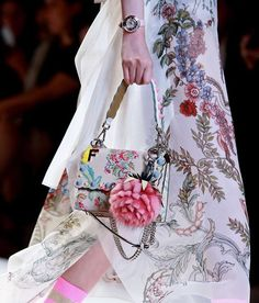 Ribbons and bows adorn the lavish new looks of #FendiSS17 while our beloved bag charms get a fresh new shape. #MFW