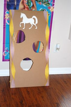 Tangled birthday party game - Maximus apple toss