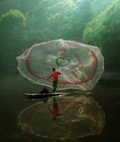 I think this is photoshopped, but a impressive net casting! #fishing