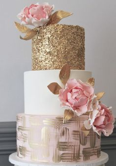 Featured Cake: Alliance Bakery; Glamorous gold and pink three tier wedding cake