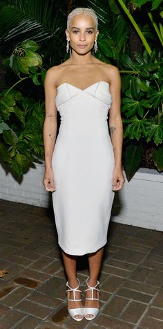 Tempered, yet not without her signature edge—Zoe Kravitz slipped into a crepe strapless LWD by Brandon Maxwell and styled the number with a set of cascading Swati Dhanak earrings and white satin strappy Louboutin sandals.