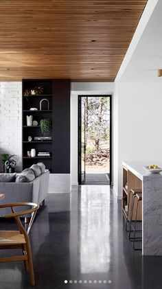 Burnished concrete floors; wood panelling on ceiling