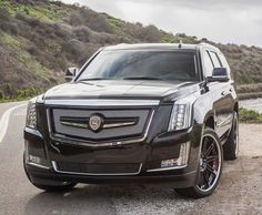 """This one won't get lost in the parking lot. Strut styling pieces and 24"""" wheels. Personalize your SUV and enhance your driving experience. Contact us for a style session:   #suv #cadillac #escalade #customsuv #pimpwagon #rims #24s #customwheels #luxurylifestyle #kingofprussia #t1m  Are you ready for this winter season? Contact us today for a remote car starter installed by our trained technicians."""