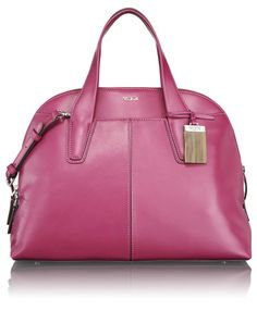 Lucky Magazine deems Tumi's leather Carlisle attache ($445) as one of the best bright, briefcase bags for women ever. It is fashion forward while still appropriate and is roomy enough to fit a laptop, casual/gym clothes, an iPad, makeup case, newspaper, sandals, and more. The dark fuchsia stands out while still looking gorgeous against business colors (navy, black, camel, etc.).