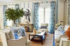 As a blue-and-white addicted person, Timothy Corrigan's line of fabrics for Schumacher (displayed in this lovely living room) is pretty much perfection. I am very into matching your draperies to your round skirted center table. Living Room Styles, My Living Room, Living Spaces, Blue Curtains, Tablecloth Curtains, Blue Rooms, White Decor, Bunt, Interior Inspiration