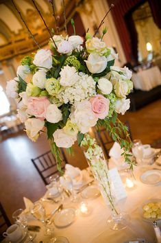 Flowers & Fancies centerpiece with pink roses, white hydrangea and blush peonies