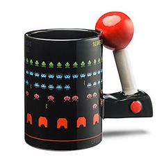 ThinkGeek celebrates old-school arcade culture with this mug. The exterior features a game of Space Invaders and the handle looks like an old-school joystick.
