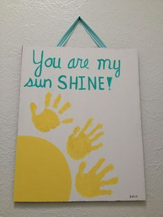 DIY - You are my sunshine artwork with children hand prints. Too easy and had fun with the kids making it!! Was perfect for the rainy day.