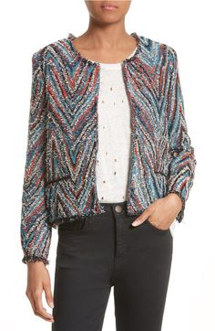 Psychedelic tweed blazer's do exist! This ecelectically cool one features a collarless jacket and subtle eyelash trim.