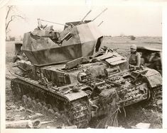 """Destroyed German Flakpanzer IV """"Wirbelwind"""". A destroyed Nazi anti-aircraft gun. These were based on the Panzer IV tank. Basically, the Panzer's turret was removed and replaced with an open-top, nine-sided turret which housed a quadruple 2 cm Flakvierling 38 L/112.5. Apparently, there were less than a hundred of these things produced during the war."""