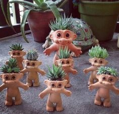 Troll Succulents - I couldn't do this to my own childhood trolls, so it's time to hit some garage sales!!!