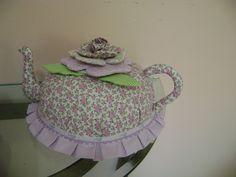 cobre bolo  em tecido de algodão com estampado de lilás  pode retirar para lavar  em flor de alto relevo  um lindo presente para sua cozinha  temos outras estampas de tecidos