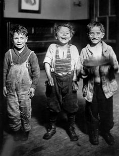 Three boys at Hull House in Chicago. Photograph from the Chicago Daily News. ICHi-01544