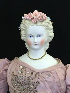 """22"""" PARIAN SHOULDER HEAD LADY WITH MOLDED NECKLACE AND ELABORATE APPLIED FLOWERS.  MOLDED AND PAINTED FANCY HAIRSTYLE AND FACIAL FEATURES, ON ANTIQUE STITCH JOINTED CLOTH BODY WITH NEWER KID LOWER ARMS."""